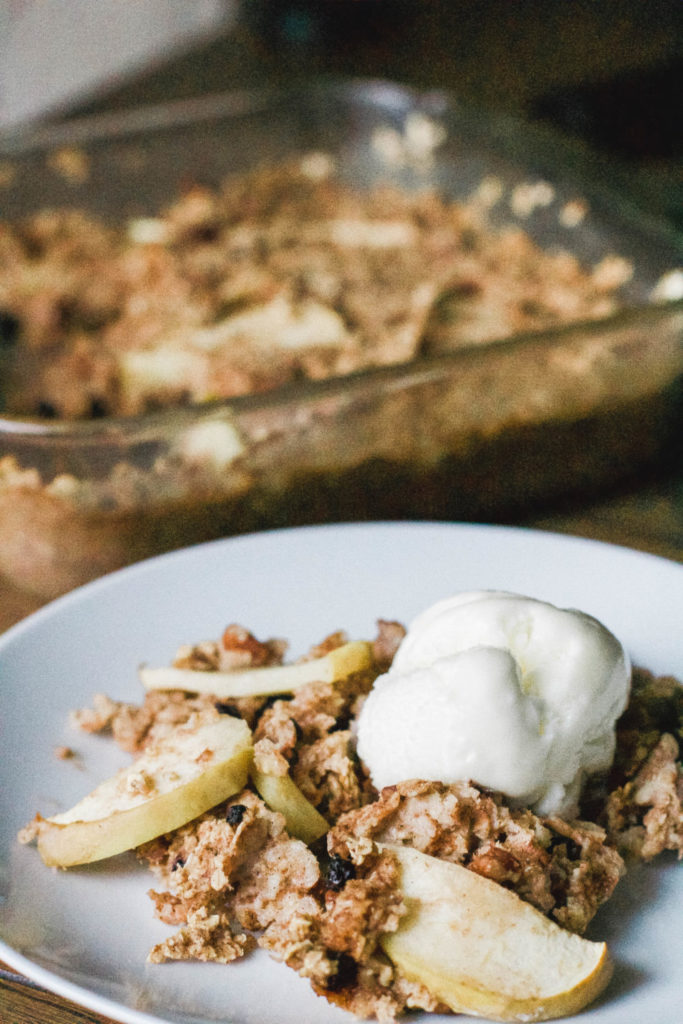Baked Oatmeal Apple Crisp is a one pan dish - simply mix ingredients, bake, and serve as a dessert or a healthy, wholesome morning breakfast. Gluten-free, vegan and refined sugar free! Fall Desserts | Fall Recipes | Granny Smith Apples | Healthy | Dessert for Breakfast | Plant Based | Ice cream | Autumn | Cinnamon | Easy Recipes | Sweets | Dessert Food | Baked Oatmeal | Gluten-free Oats | Less